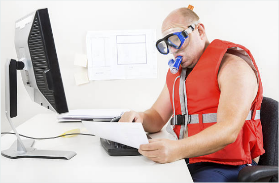 Business Man in Life Jacket showing how vital Cloud Backups are